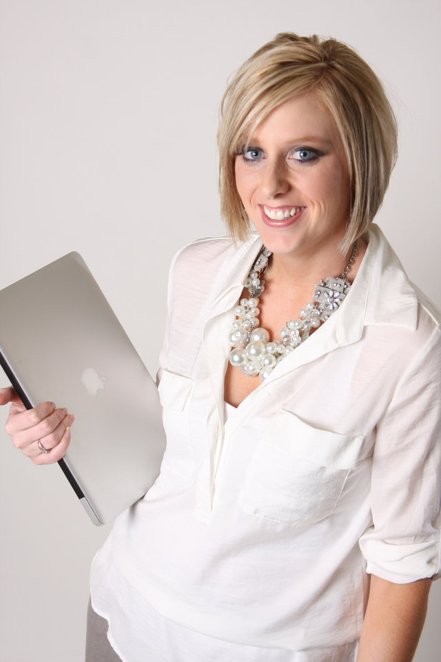 Photo - Emily Ginn is shown holding her computer.  PHOTO PROVIDED