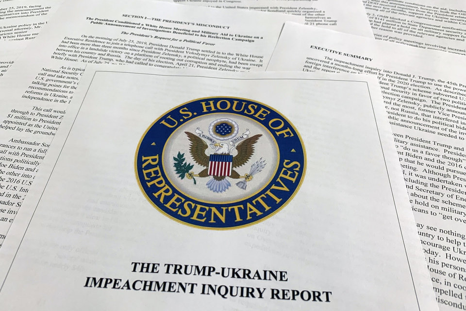 Photo -  The report from Democrats on the House Intelligence Committee on the impeachment inquiry into President Donald Trump is photographed Tuesday in Washington. [Jon Elswick/The Associated Press]