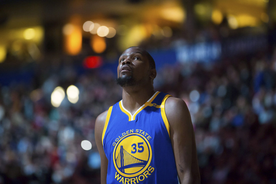 Photo - Golden State Warriors' Kevin Durant looks on before a preseason NBA basketball game against the Toronto Raptors, in Vancouver, British Columbia, Saturday Oct. 1, 2016. (Darryl Dyck/The Canadian Press via AP)