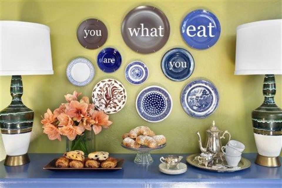 Photo - This undated photo courtesy of Sarah Dorio shows a room designed by Brian Patrick Flynn for HGTV.com. This room demonstrates how Flynn adds food-related quotes to dinner plates with decals, then hangs with plate hangers as affordable dining room art.   (AP Photo/Sarah Dorio)