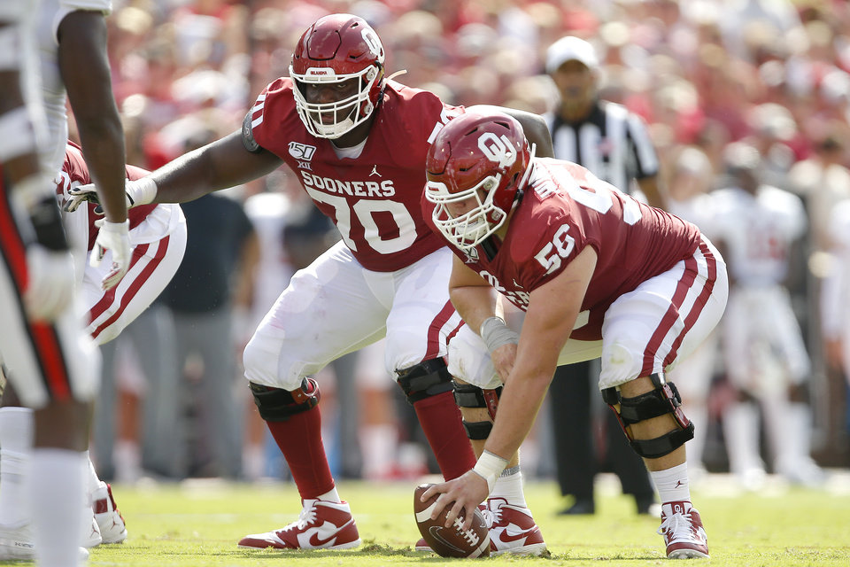 Photo - Oklahoma's Creed Humphrey (56) and Brey Walker (70) get ready for a play during a college football game between the University of Oklahoma Sooners (OU) and Texas Tech University at Gaylord Family-Oklahoma Memorial Stadium in Norman, Okla., Saturday, Sept. 28, 2019. Oklahoma won 55-16. [Bryan Terry/The Oklahoman]