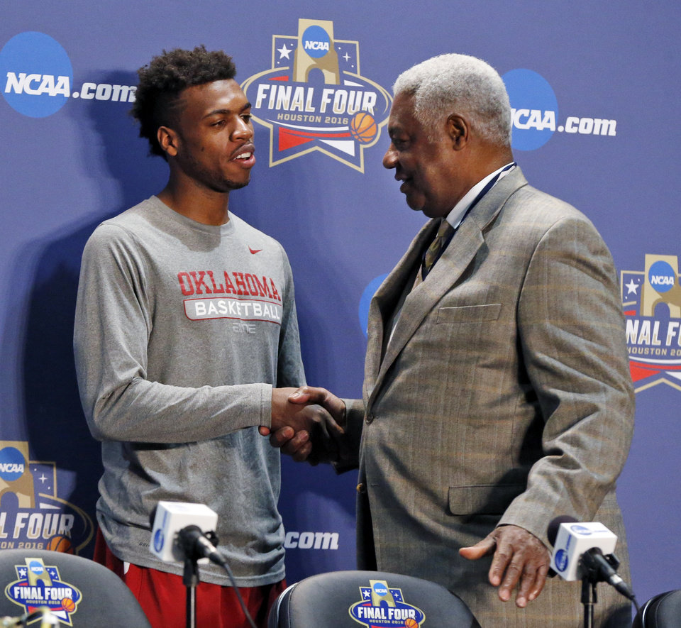 Photo - Oklahoma's Buddy Hield (24), left, and Oscar Robertson shake hands after the announcement that Hield won the U.S. Basketball Writers Association's Oscar Robertson Trophy at Final Four Friday before the national semifinal between the Oklahoma Sooners and the Villanova Wildcats in the NCAA Men's Basketball Championship at NRG Stadium in Houston, Friday, April 1, 2016. OU will play Villanova in the Final Four on Saturday. Photo by Nate Billings, The Oklahoman