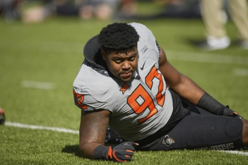 Photo -  Oklahoma State defensive tackle Cameron Murray has 13 tackles, six solo stops, 2.5 tackles for loss, two quarterback hurries and one sack this season. [AP Photo/Brody Schmidt]