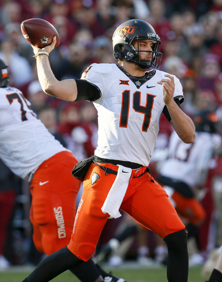 Photo - Oklahoma State's Taylor Cornelius (14) passes during a Bedlam college football game between the University of Oklahoma Sooners (OU) and the Oklahoma State University Cowboys (OSU) at Gaylord Family-Oklahoma Memorial Stadium in Norman, Okla., Nov. 10, 2018. Photo by Nate Billings, The Oklahoman