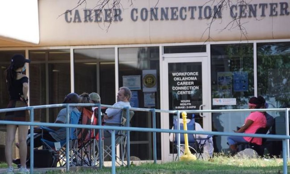 Photo -  People, some who arrived before dawn, wait in line Wednesday outside the Workforce Oklahoma Career Connection Center in hopes of getting a walk-in appointment to resolve issues with their unemployment payments. [Ellie Melero/The Oklahoman]