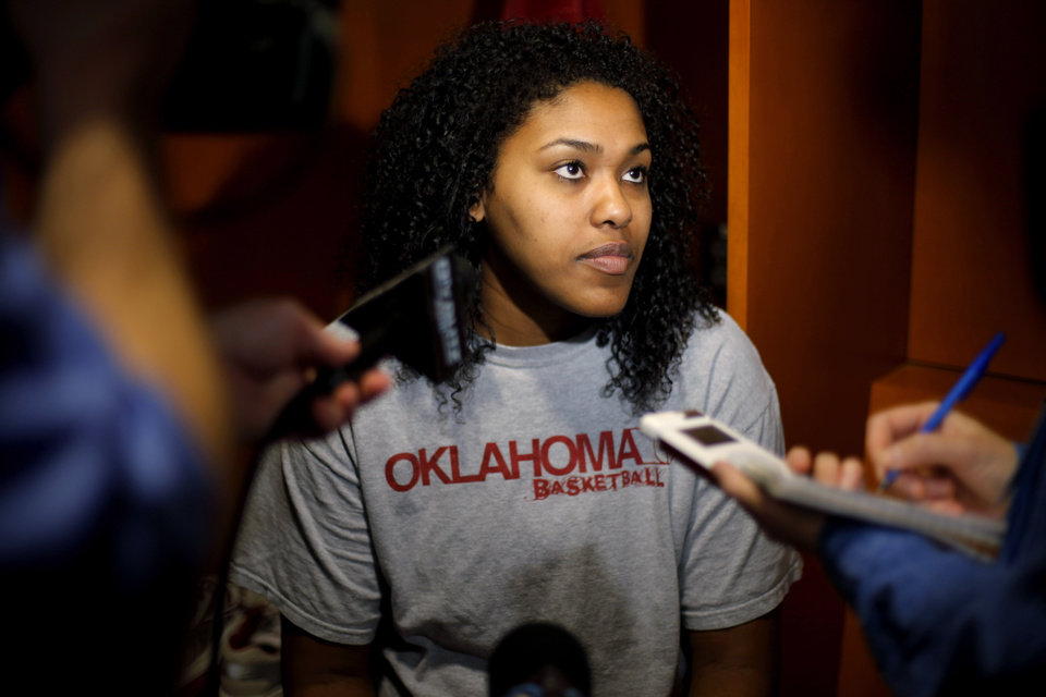 Photo - OU's Abi Olajuwon is interviewed in the locker room in Kansas City, Mo., on Monday, March 29, 2010. Oklahoma will play Kentucky in the regional championship game of the NCAA women's tournament on Tuesday, March 29, 2010.