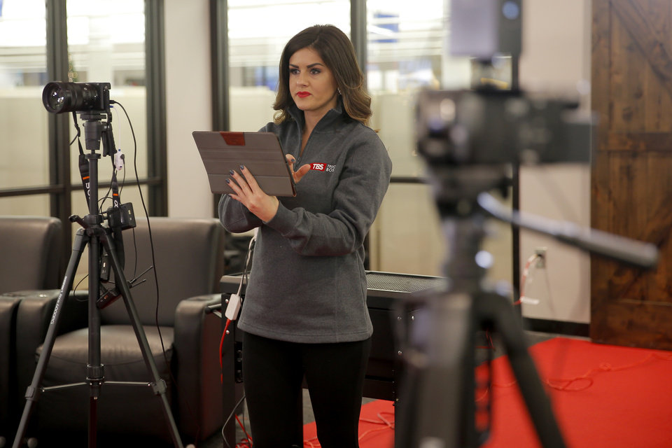 Photo -  Niki Weibel gets ready to record a video inside the TBS Factoring Service studio.
