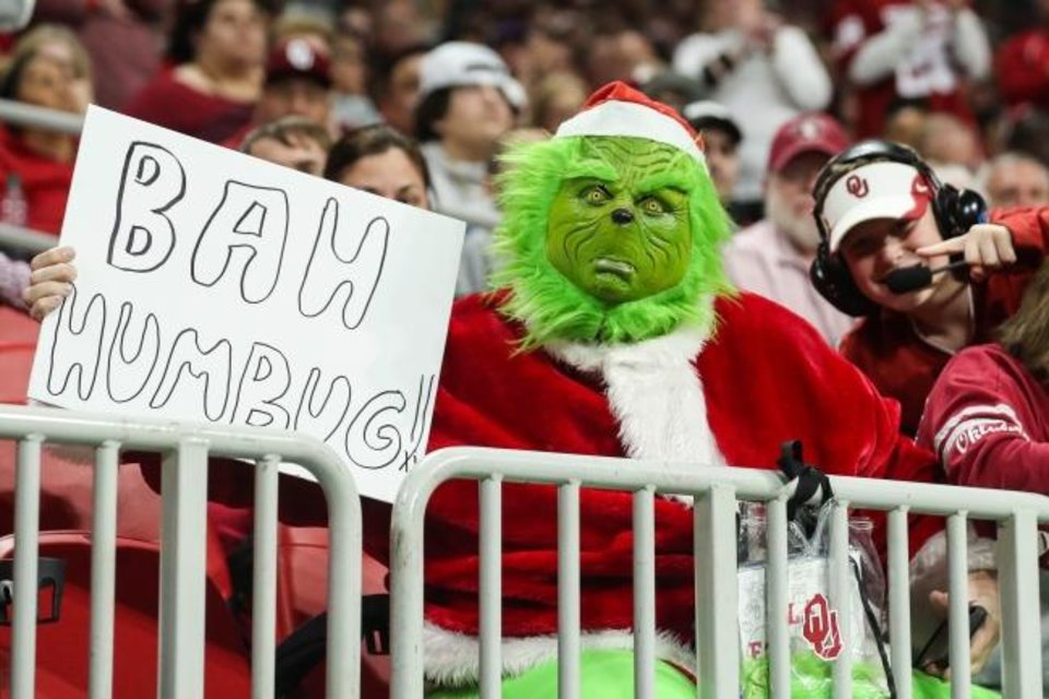 Photo -  Sooner fans don't hide their feelings of how the game went during a 63-28 loss to LSU on Saturday. [Jason Getz/USA TODAY Sports]