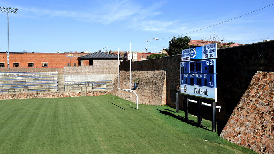 Photo - The north end of  Jelsma Stadium  leads into the underground bridge below the paved street surface at the intersection of Harrison Ave. and Wentz St. just east of downtown Guthrie. The field and north wall are shown here on Thursday, July 6, 2017.  Jelsma Stadium is the home field for the Guthrie Bluejays.  The story is an overview of the history of the bridge, as it sits over the stadium's old locker room.  The stadium, which features sandstone walls, was built in the 1930s during the Depression.  Photo by Jim Beckel, The Oklahoman
