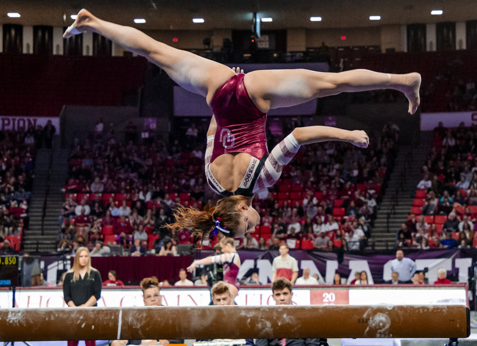 Photo - University of Oklahoma's Anastasia Webb competes in the beam during the women's gymnastics competition between the University of Oklahoma and Arkansas at the Lloyd Noble Center in Norman, Okla Monday, Jan. 20, 2020.   [Chris Landsberger/The Oklahoman]