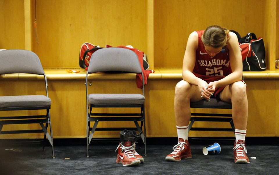 Photo - Oklahoma's Whitney Hand (25) reacts after losing to Tennessee at the  Oklahoma City Regional for the NCAA women's college basketball tournament at Chesapeake Energy Arena in Oklahoma City, Sunday, March 31, 2013. Photo by Sarah Phipps, The Oklahoman