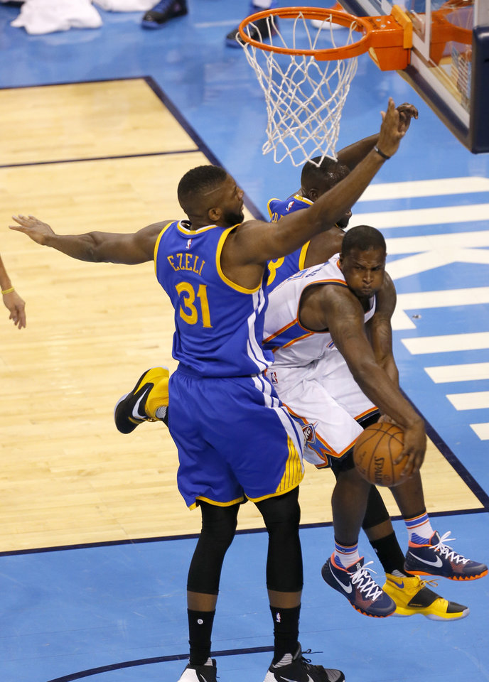 Photo - Oklahoma City's Dion Waiters (3) passes the ball as Golden State 's Festus Ezeli (31) defends during Game 3 of the Western Conference finals in the NBA playoffs between the Oklahoma City Thunder and the Golden State Warriors at Chesapeake Energy Arena in Oklahoma City, Sunday, May 22, 2016. Photo by Sarah Phipps, The Oklahoman