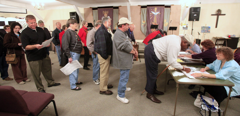 Photo - People line up to vote at precinct 460 in Oklahoma City Tuesday, Nov. 2, 2010. Photo by Paul B. Southerland, The Oklahoman