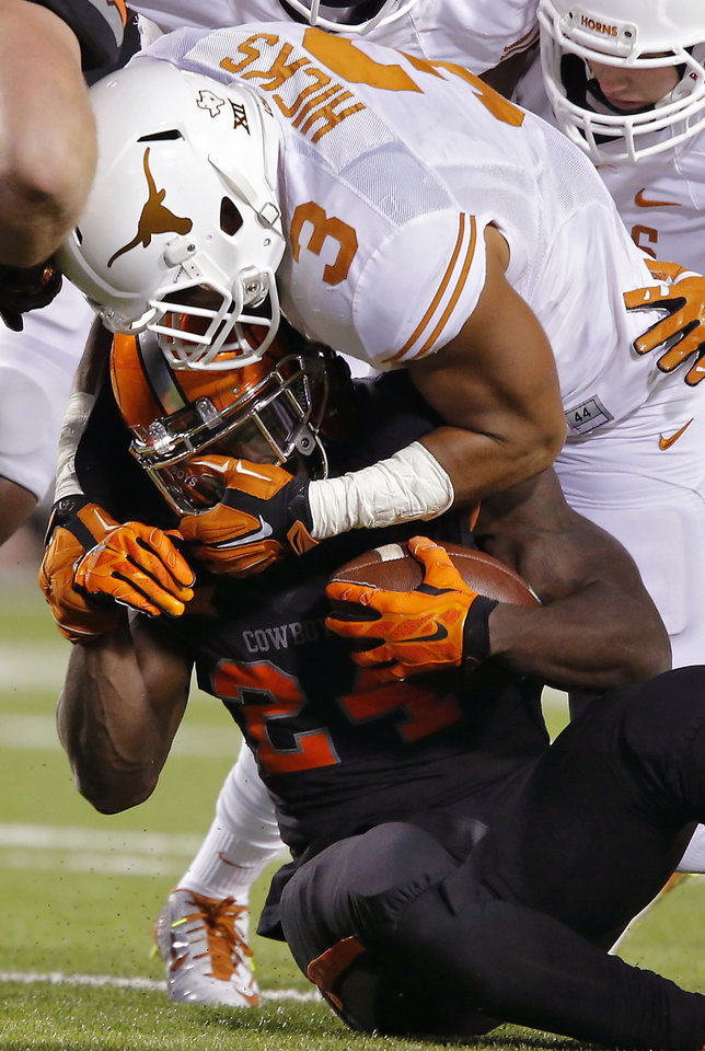 Photo - Texas' Jordan Hicks (3) stops Oklahoma State's Tyreek Hill (24) during the college football game between the Oklahoma State University Cowboys (OSU) the University of Texas Longhorns (UT) at Boone Pickens Staduim in Stillwater, Okla. on Saturday, Nov. 15, 2014.  Photo by Chris Landsberger, The Oklahoman