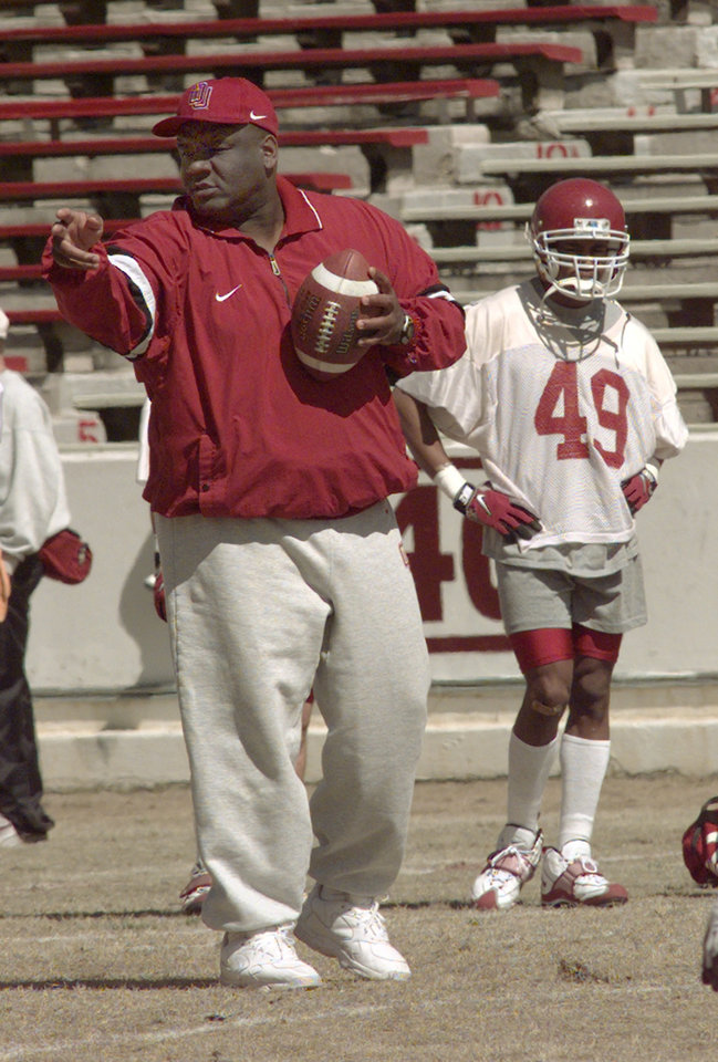 Photo - OU head football coach John Blake during spring practice Saturday afternoon.