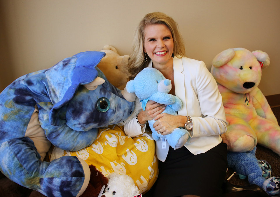 Photo -  Erin E. Engelke, new executive director of Calm Waters Center for Children and Families, hangs out with