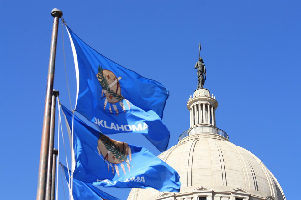 Photo - State flags fly at the Oklahoma Capitol. [The Oklahoman archives]