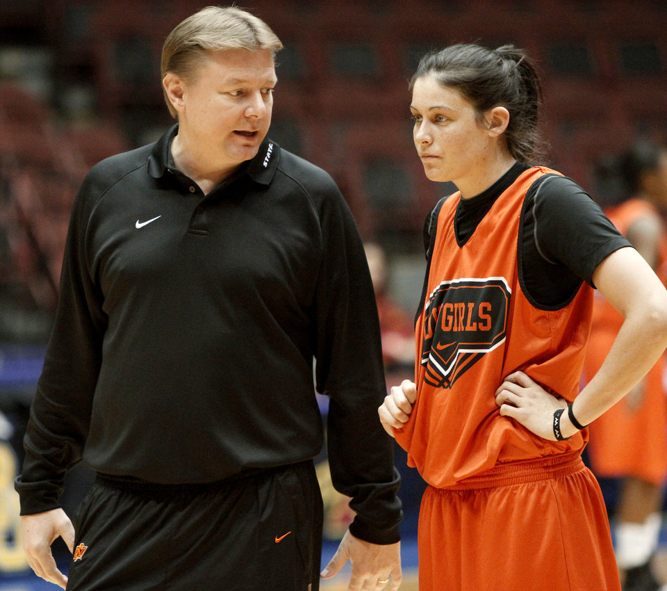 Photo - Oklahoma State head coach Kurt Budke talks to Tegan Cunningham during a practice before the Women's Big 12 Championship tournament  in Kansas City, Mo., Wednesday, March 10, 2010.  Photo by Bryan Terry, The Oklahoman