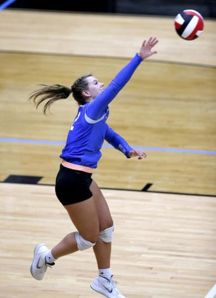 Photo -  Deer Creek's Teagan Polcovich serves during a three-set sweep Tuesday at Mustang. [Sarah Phipps/The Oklahoman]