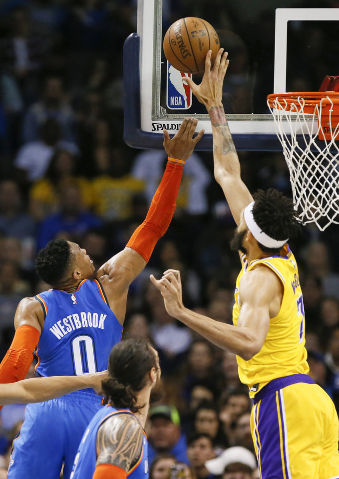 Photo - Los Angeles' JaVale McGee (7) blocks a shot by Oklahoma City's Russell Westbrook (0) in the third quarter during an NBA basketball game between the Los Angeles Lakers and the Oklahoma City Thunder at Chesapeake Energy Arena in Oklahoma City, Thursday, Jan. 17, 2019. Los Angeles won 128-138 in overtime. Photo by Nate Billings, The Oklahoman