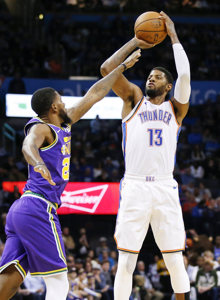 Photo -  Oklahoma City's Paul George shoots against Utah's Royce O'Neale during Monday's game.  [Photo by Nate Billings, The Oklahoman]