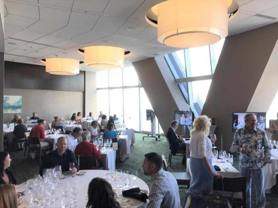Photo -  A socially distanced wine dinner at Vast in Oklahoma City. [Dave Cathey/The Oklahoman]