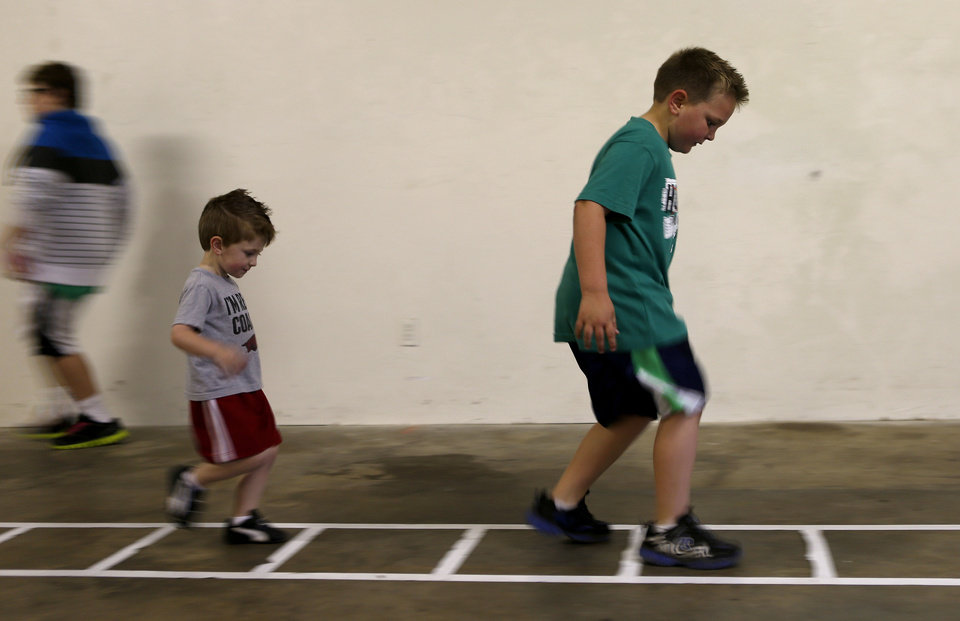 Photo - Jaiden Pertree, 8, and Christian Pertree, 4, workout at Kid's Maniac Fitness in Moore, Okla., Tuesday, April 9, 2013. Photo by Bryan Terry, The Oklahoman  Bryan Terry