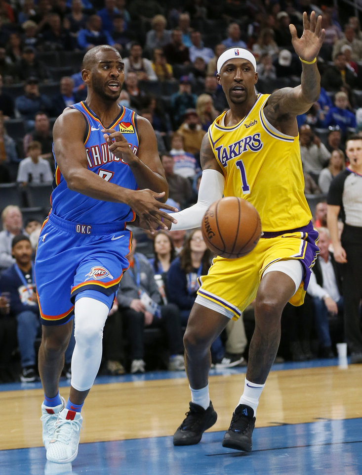 Photo - Oklahoma City's Chris Paul (3) passes around Los Angeles' Kentavious Caldwell-Pope (1) in the first quarter during an NBA basketball game between the Oklahoma City Thunder and the Los Angeles Lakers at Chesapeake Energy Arena in Oklahoma City, Friday, Nov. 22, 2019. [Nate Billings/The Oklahoman]