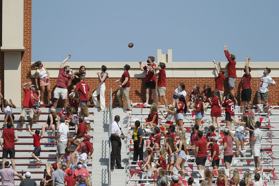 Photo - Oklahoma fans throw the football used for a Kansas State extra point over the top of the north side of the stadium during a college football game between the University of Oklahoma Sooners (OU) and the Kansas State Wildcats at Gaylord Family-Oklahoma Memorial Stadium in Norman, Okla., Saturday, Sept. 26, 2020. Kansas State won 38-35. [Bryan Terry/The Oklahoman]