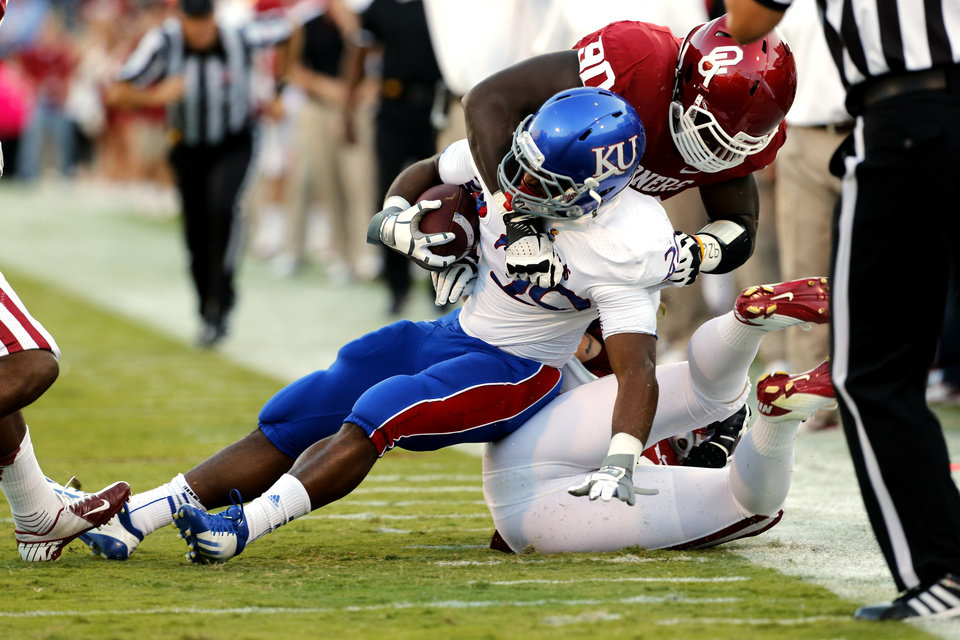 Photo - James Sims (29) is brought down by Oklahoma Sooners's David King (90) and Tom Wort (21) during the college football game between the University of Oklahoma Sooners (OU) and the University of Kansas Jayhawks (KU) at Gaylord Family-Oklahoma Memorial Stadium in Norman, Okla., on Saturday, Oct. 20, 2012. Photo by Steve Sisney, The Oklahoman