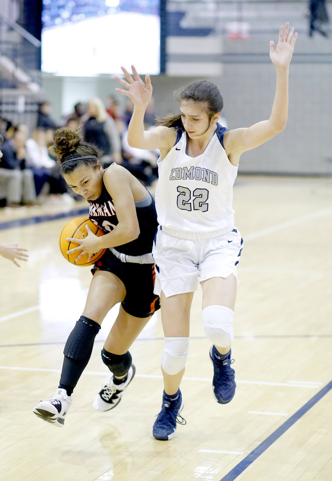 Photo - Norman's Kelbie Washington gets by Edmond North's Toni Papahronis during the high school girls game between Edmond North and Norman at Edmon North in Edmond, Okla., Friday, Jan. 17, 2020.  [Sarah Phipps/The Oklahoman]