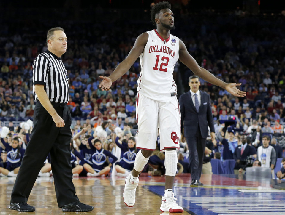 Photo - Oklahoma's Khadeem Lattin (12) reacts to fouling out during the national semifinal between the Oklahoma Sooners (OU) and the Villanova Wildcats in the Final Four of the NCAA Men's Basketball Championship at NRG Stadium in Houston, Saturday, April 2, 2016. Photo by Nate Billings, The Oklahoman