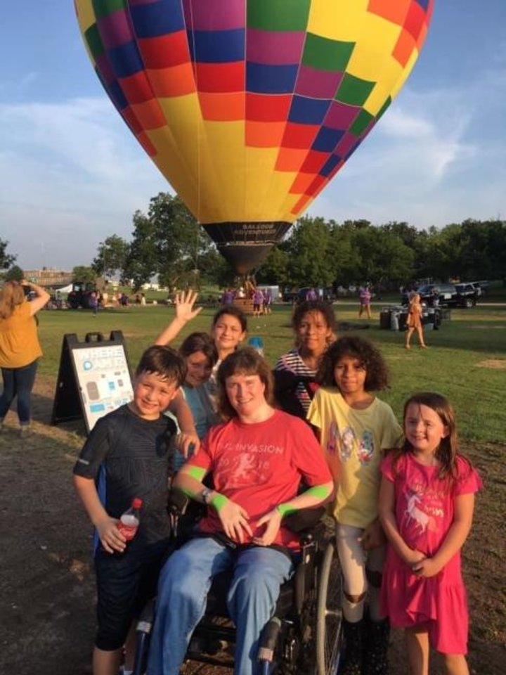 Photo -  Leah Campbell, center, prepares to go on a tethered hot air balloon ride for her birthday in 2019. [Photo provided]