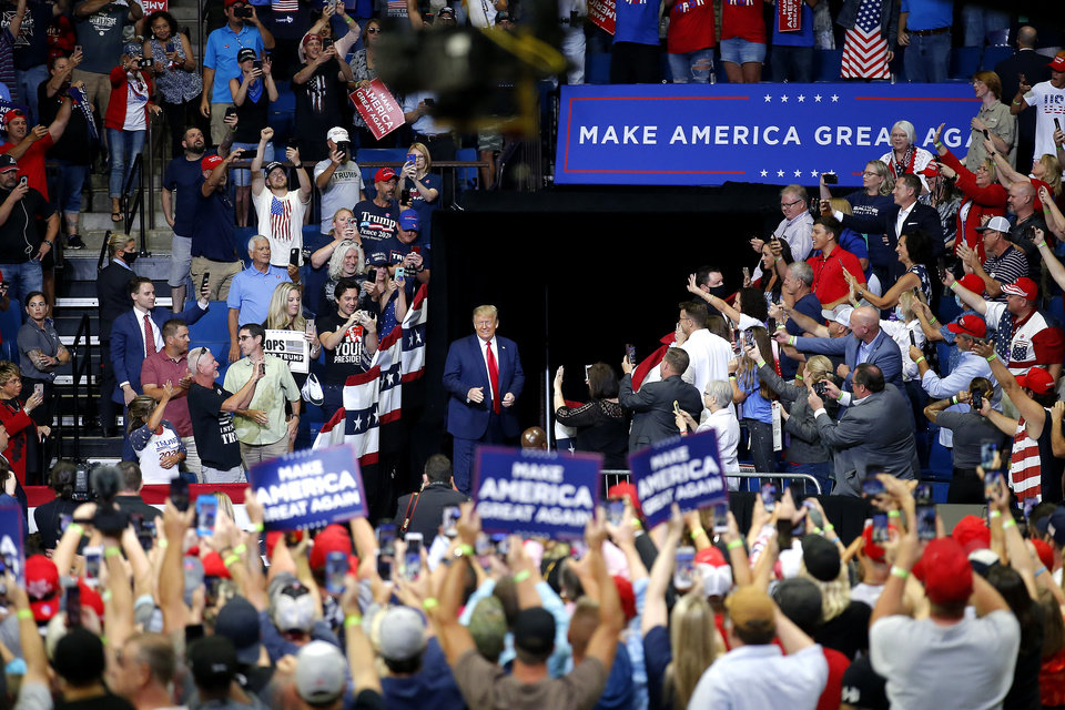 Photo - President Donald Trump enters the arena for his rally at the BOK Center in Tulsa, Okla., Saturday, June 20, 2020. [Sarah Phipps/The Oklahoman]