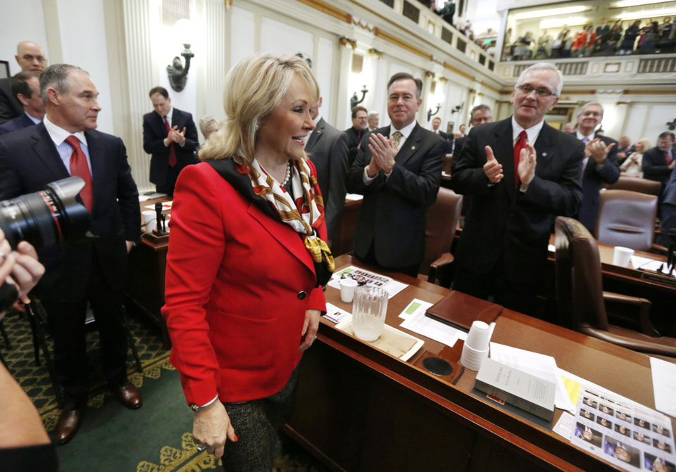 Photo - Governor Mary Fallin arrives on the floor of the House of Representatives to deliver the State of the State address at the State Capitol in Oklahoma City, Okla. Monday, Feb. 6, 2017.  Photo by Paul Hellstern, The Oklahoman