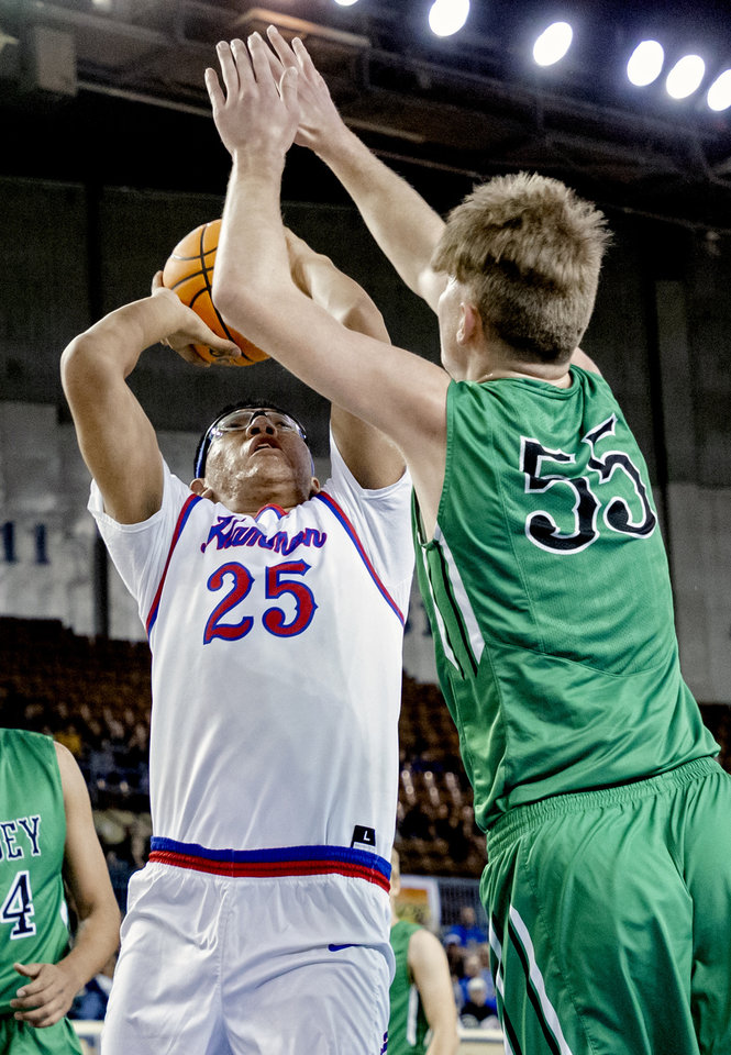 Photo - Leedey's Nathan Hill (55) defends a shot on Hammon's Frank Whiteskunk (25) during a Class B boys state tournament semi-final basketball game between Hammon vs Leedey in the Jim Norick Arena at State Fair Park in Oklahoma City, Okla. on Friday, March 6, 2020.  [Chris Landsberger/The Oklahoman]