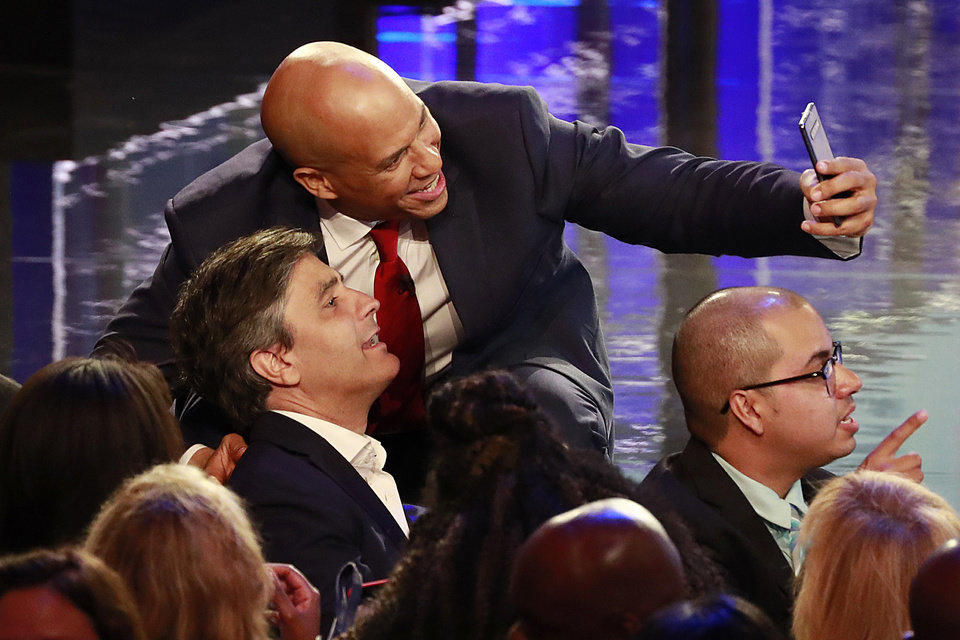 Photo - Democratic presidential candidate Sen. Cory Booker, D-N.J., takes a selfie with a supporter at the end of a Democratic primary debate hosted by NBC News at the Adrienne Arsht Center for the Performing Arts, Thursday, June 27, 2019, in Miami. (AP Photo/Wilfredo Lee)