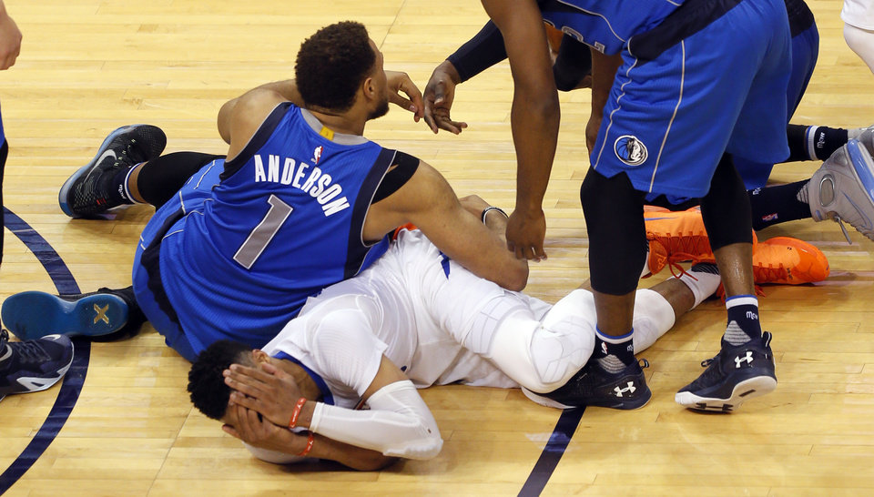 Photo - Oklahoma City's Russell Westbrook (0) reacts after fighting Dallas' Justin Anderson (1) for a loose ball during Game 5 of the first round series between the Oklahoma City Thunder and the Dallas Mavericks in the NBA playoffs at Chesapeake Energy Arena in Oklahoma City, Monday, April 25, 2016. Photo by Sarah Phipps, The Oklahoman