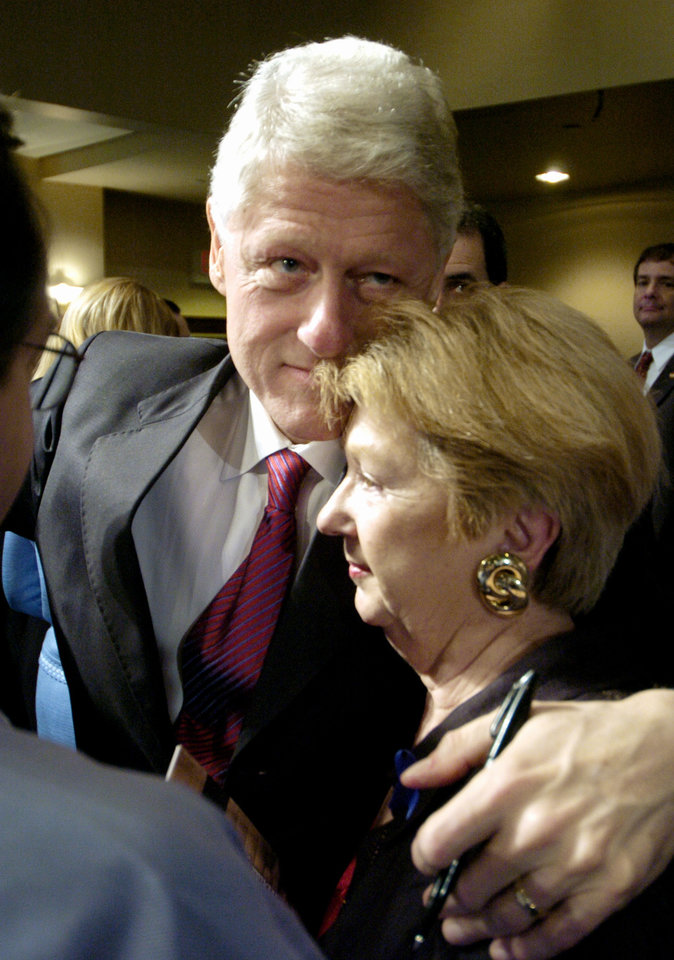 Photo - Oklahoma City National Memorial 10th Anniversary, Tuesday, April 19, 2005,  Former President Bill Clinton gives a hug to Lois Welch, wife of Bud Welch, whose daughter was killed in the OKC bombing, after a ceremony honoring those who died and those who survived in the April 19, 1995 bombing of the Alfred P. Murrah Federal Building, during a ceremony at the First United Methodist Church, in Oklahoma City. (Paul Hellstern/The Oklahoman/POOL)
