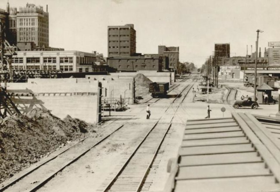 Photo -  This 1932 photograph shows how construction was proceeding on the elevated portion of the Santa Fe tracks downtown. [OKLAHOMAN ARCHIVES]