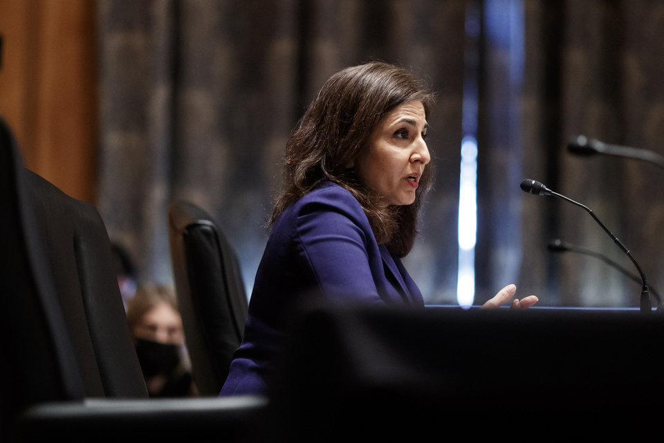 Photo -  Neera Tanden testifies before the Senate Homeland Security and Government Affairs committee on her nomination to become the Director of the Office of Management and Budget (OMB), during a hearing Tuesday, Feb. 9, 2021 on Capitol Hill in Washington.  (Ting Shen/Pool via AP)
