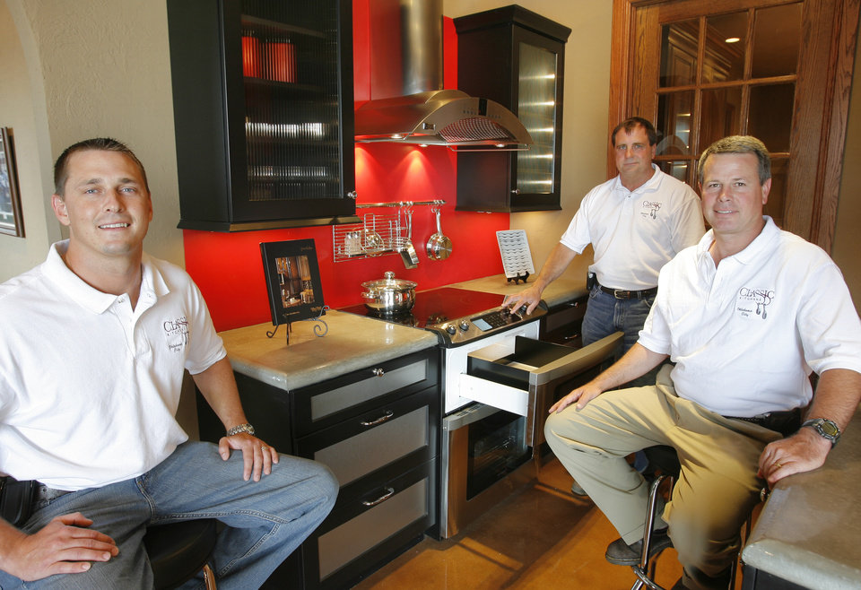 ordinary Classic Kitchens Okc #7: Photo - Grant Parcell, Zachary Taylor and Stephen Wells in a display kitchen at Classic