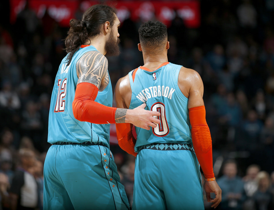 Photo - Oklahoma City's Steven Adams (12) and Russell Westbrook (0) during the NBA basketball game between the Oklahoma City Thunder and the Memphis Grizzlies at the Chesapeake Energy Arena, Sunday, March 3, 2019. Photo by Sarah Phipps, The Oklahoman