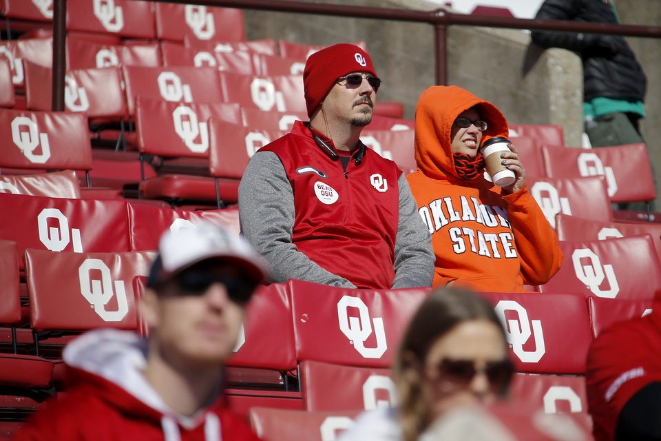 Photo - Kevin Isom and Heather Lapczuk of Muskogee wait for the start of a Bedlam college football game between the University of Oklahoma Sooners (OU) and the Oklahoma State University Cowboys (OSU) at Gaylord Family-Oklahoma Memorial Stadium in Norman, Okla., Nov. 10, 2018.  Photo by Bryan Terry, The Oklahoman