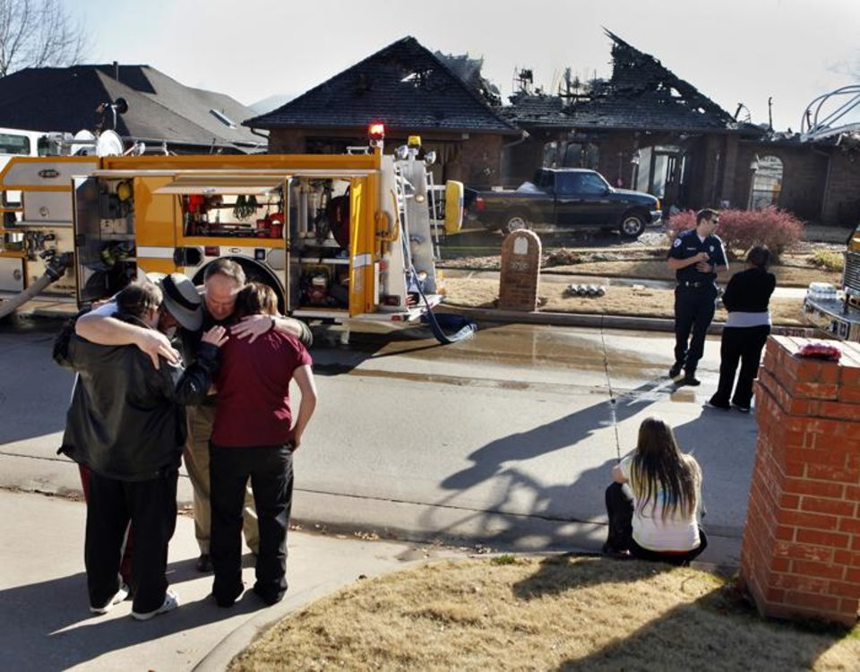 Photo -  HOUSE FIRE: Norman firefighters responded to a fire at 3700 Burlington at 1:28 pm on Friday, Dec. 18, 2009, in Norman, Okla.   Embers from the first fire caught the roof of a house at 3617 Glenbrook on fire.  The Burlington house was a total loss and damage was estimated at $375,000.  The damage to the house on Glenbrook was $100,000.  Photo by Steve Sisney, The Oklahoman ORG XMIT: KOD