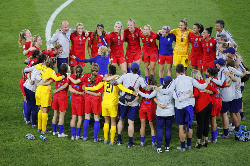 Photo - US players celebrate after the Women's World Cup semifinal soccer match between England and the United States, at the Stade de Lyon outside Lyon, France, Tuesday, July 2, 2019. US won 2-1. (AP Photo/Francois Mori)