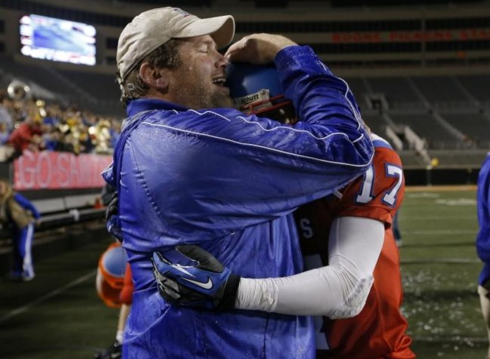 Photo -  OCS coach Derek Turner, left, celebrates with Blake Summers following the Class 2A state championship win over Davis in 2012 at Boone Pickens Stadium in Stillwater. [OKLAHOMAN ARCHIVE]