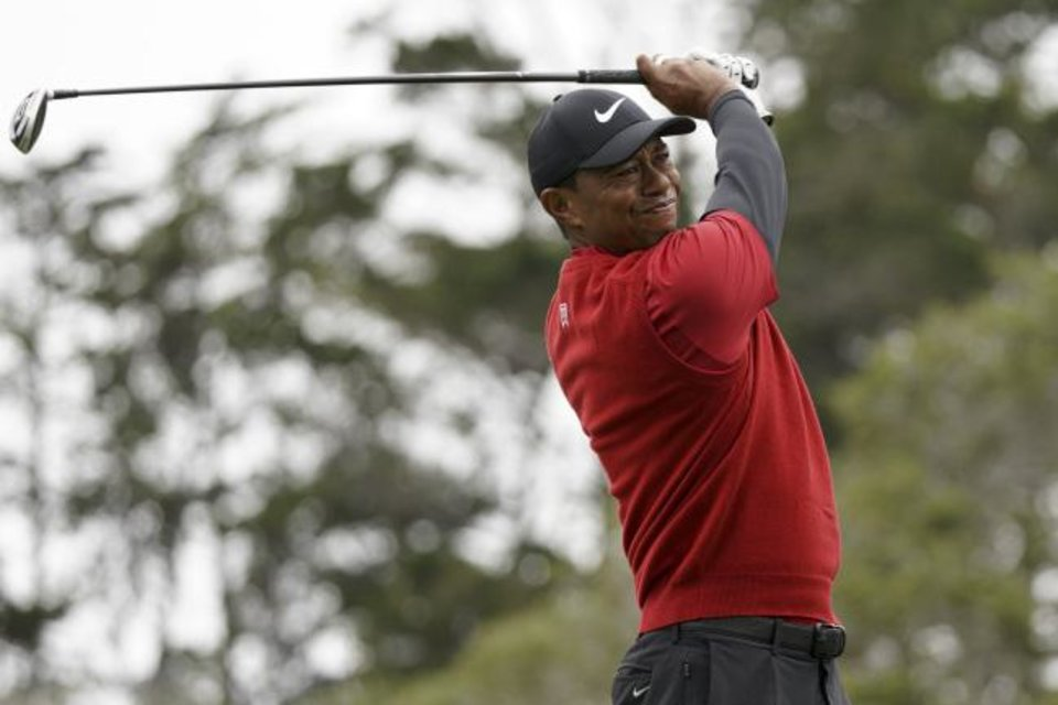 Photo -  Tiger Woods watches his tee shot on the second hole during the final round of the U.S. Open Championship golf tournament on Sunday in Pebble Beach, Calif. [AP Photo/Carolyn Kaster]