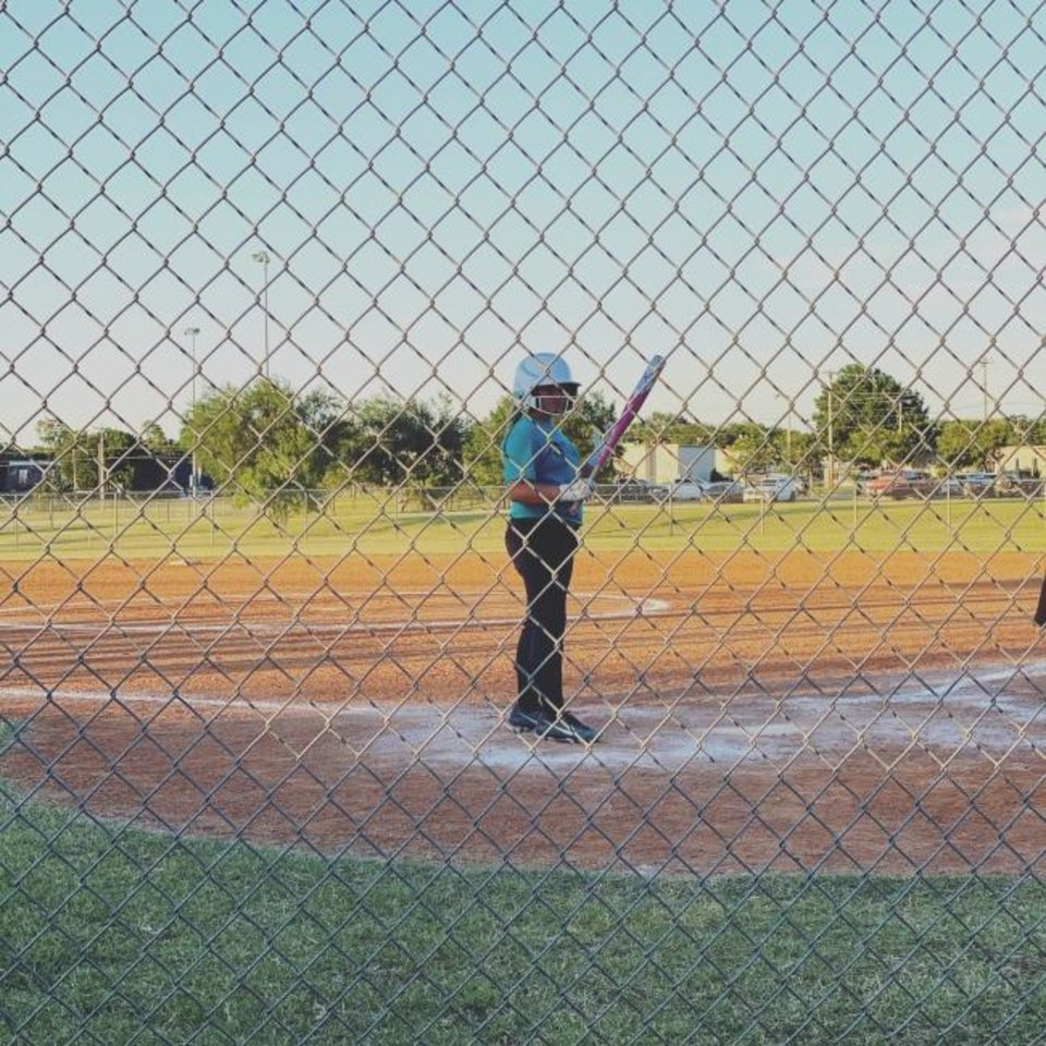Photo -  Sadie Argyle, 10-year-old granddaughter of Oklahoman sports columnist Berry Tramel, stands at home plate, waiting to lead off an inning. [PHOTO PROVIDED]