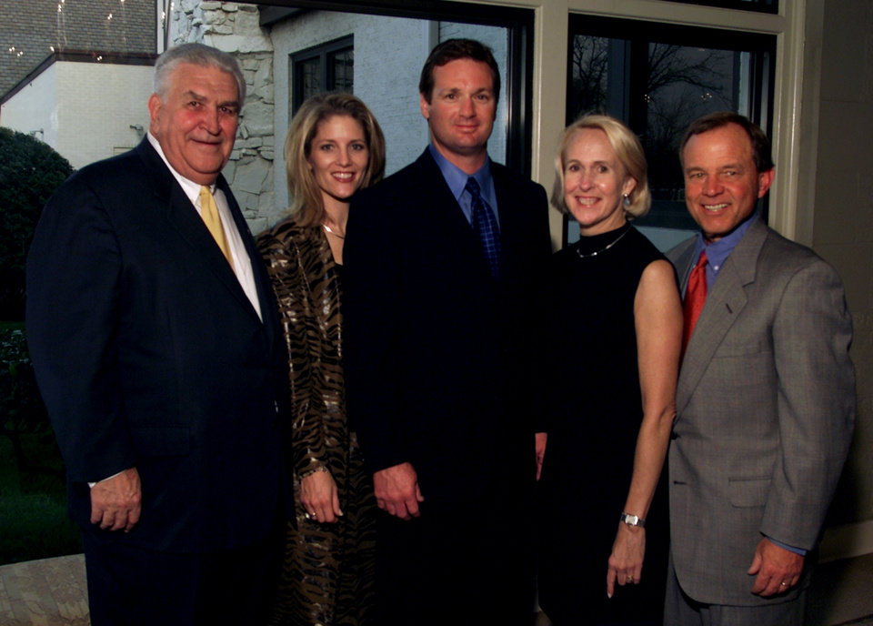 Photo - HONOR HONOREE: Bob Stoops, (center) head football coach of the University of Oklahoma, received this year's Tribute to Excellence Award during the Oklahoma Chapter of the Arthritis Foundation gala April 11, 2002.  Pictured with Stoops are  Lee Allan Smith (left), Carol Stoops (wife), Christy and James H. (Jim) Everest.  Staff photo by Steve Sisney